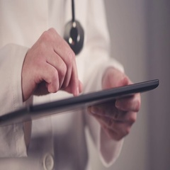 Close up of medical professional female hands using tablet computer Stock Footage