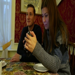 Lovely couple look at photos, woman hold camera and browse images, examine Stock Footage
