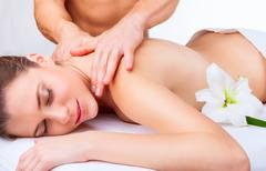 Beautiful woman getting a massage on a white background Stock Photos