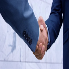 Business Partners Closing The Deal With Handshake Stock Footage