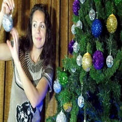 New Year, Christmas girl decorates a Christmas tree Stock Footage