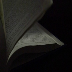 Flipping book pages over black background Stock Footage
