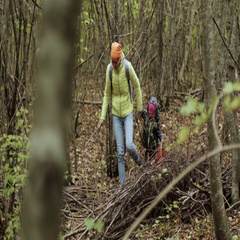 Mother and daughter in warm jackets walking in the autumn forest Stock Footage