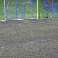 Footballer boy playing football on artificial turf Stock Footage
