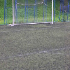 Teenager practicing football on artificial turf Stock Footage