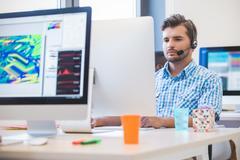 Startup business, software developer working on desktop computer Kuvituskuvat