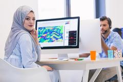 Young Arabic business woman wearing hijab,working in her startup Stock Photos