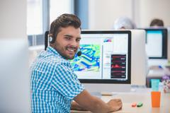Casually Dressed Man Working In Design Studio Stock Photos