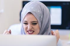 Portrait of Arabian woman looks angry while working on laptop Stock Photos