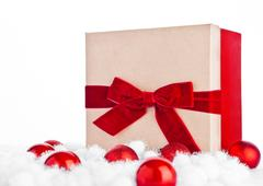 Red gift box for christmas with toys and snow on white background Stock Photos