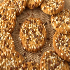 Delicious yummy freshly baked homemade cookies rotating on a sackcloth. Looped Stock Footage