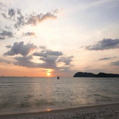 Tropical island seascape sunset, clouds move, evening to night time lapse Stock Footage
