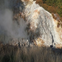 Steam from a fumarole in a ridge of a geothermal valley Stock Footage