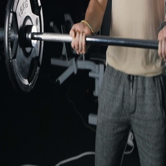 Side view of athlete doing Barbell Curl Stock Footage
