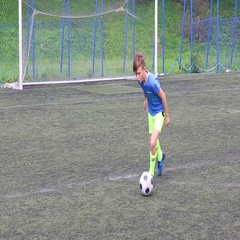 Footballer teenager playing football on artificial turf Stock Footage