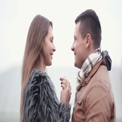 Happy man and woman in love cheerfully laugh, kiss, hug each other. Happy Stock Footage