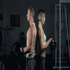 Athletic couple of man and woman doing Barbell Curl Stock Footage