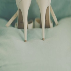 Close up of a brides wedding shoes Stock Footage