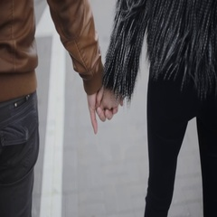 People in happy relationship. Backview of a loving couple holding hands, walking Stock Footage