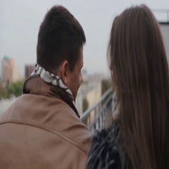 Happy love. Backview of a dark-haired couple, walking on a roof, kissing Stock Footage