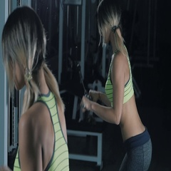 Fitness girl doing Triceps Pushdown in a gym Stock Footage