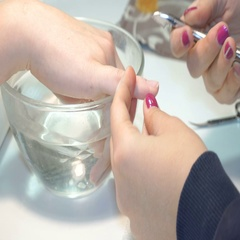 Manicurist uses professional manicure tool. Stock Footage