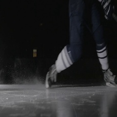 Ice hockey player shoots the puck, power slap shot in canadian style by Stock Footage