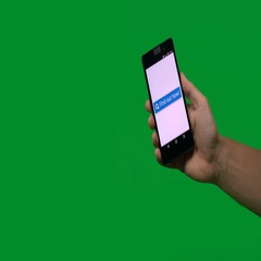 Find Out button on mobile, greenscreen Stock Footage