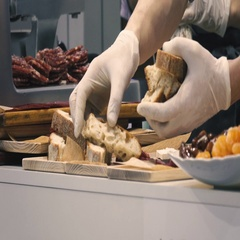Cooks hands laid sliced bread on a cutting board in a restaurant kitchen Stock Footage