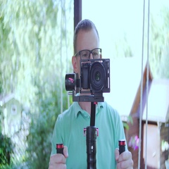 Camera Operator. The man filming with the video camera. Front view.  Stock Footage