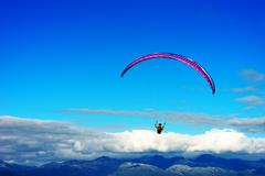 Kite flyer in the sky background Stock Photos