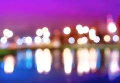 Night city lights bokeh with reflections background Stock Photos
