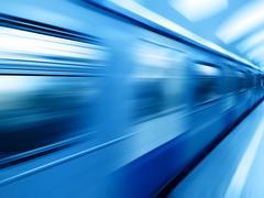 Diagonal blue motion blur metro train background Stock Photos