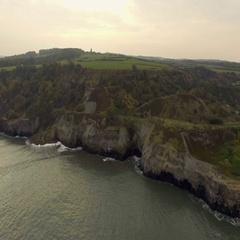 British coastline, North Sea, wild untouched nature, rocks and cliffs, aerial Stock Footage