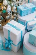 Christmas gift boxes with blue bow and bokeh lights on wooden surface Kuvituskuvat