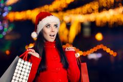 Amazed Woman With Shopping Bags in Christmas Fair Stock Photos