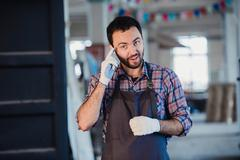 Worker show his finger in cloth glove explaining something to someone. Think on Stock Photos