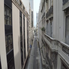 Taxi goes empty narrow street in old center Buenos Aires Stock Footage