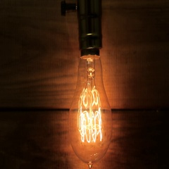 Old vintage Edison's light bulb gradually defocused and transformed into bokeh. Stock Footage