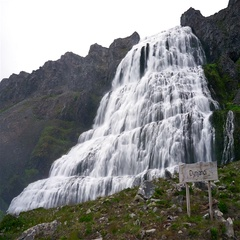 Footage of a huge Dynjandi waterfall running in cascades from a mountain. Stock Footage