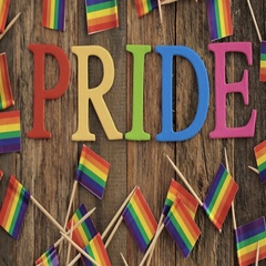 Rainbow Gay Pride sign on a wood background. Stock Footage