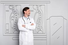 Happy smiling doctor standing at the hospital Stock Photos