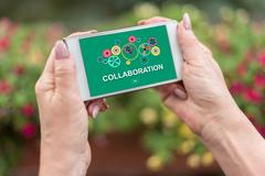 Collaboration concept on a smartphone Stock Photos