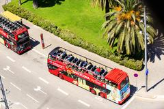 Touristic double-decker buses in Barcelona, city tour company Kuvituskuvat
