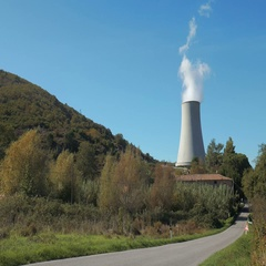 Geothermal power plant cooling tower and a road in Larderello, Italy Stock Footage