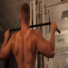 Muscular bodybuilder guy doing exercises. pulled Stock Footage