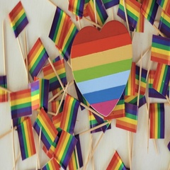 Rainbow Gay Pride small flags on wood background. Stock Footage