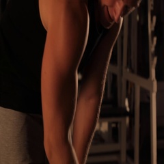 Muscular bodybuilder guy doing exercises with dumbbells in gym Stock Footage