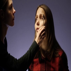 Mother makes up her daughter. 4K UHD Stock Footage