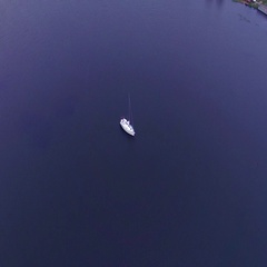 Shooting bird's eye. Drone flies over white yacht that floats on blue water. 4k  Stock Footage